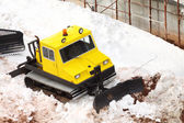 Small parked snowcat — Stock Photo