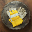 Circular saw and gloves — Stock Photo