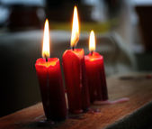 Three glowing candles — Stock Photo