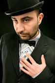 Man in suit with dollars — Stock Photo