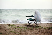 Folding chair on shore — Stock Photo