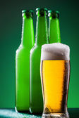 Beer bottles with full glass — Stock Photo