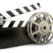 Постер, плакат: Film and clap board movies symbol closeup isolated on white