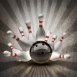 Bowling Ball crashing into the pins on vintage background. — Stock Photo #20316191