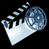 Xrey Film and clap board movies symbol closeup isolated on black. — Stock Photo