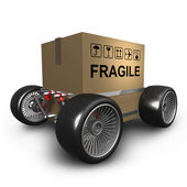 Cardboard box with big car wheel — Stock Photo