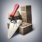 Building and construction concept. brick and metal trowel. — Foto Stock