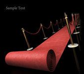 Red carpet isolated on black background — Stock Photo