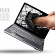 A hand comes right out of the laptop screen to shake hands CONCEPT. — Stock Photo #20324223