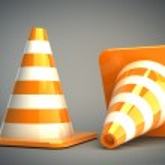 Orange highway traffic cone with white stripes — Stock Photo