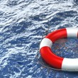 Stock Photo: Red life buoy in the water