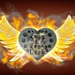 Chromed motorcycle heart engine with wings in Fire. - Stock Photo