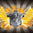 Chromed motorcycle engine with wings in Fire. - Stock Photo