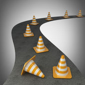 Orange highway traffic cone with white stripes on road — Stock Photo