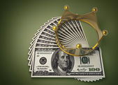 Concept golden crown and dollars — Stock Photo