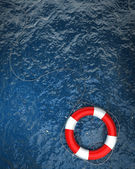 Red life buoy in the water — Photo