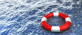 Red life buoy in the water — Stock Photo
