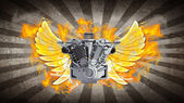 Chromed motorcycle engine with wings in Fire. — Stock Photo