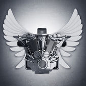 Chromed motorcycle engine with wings. — Stock Photo
