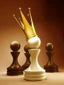 Pawn in a golden crown — Stock Photo