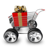 Concept SALE. shopping cart with big car wheel and RED christmas gift box isolated on white background High resolution 3d render — Stock Photo
