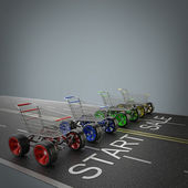 Shopping carts with big car wheel on the road — Stock Photo