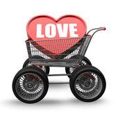 LOVE cart with big car wheel — Stock Photo