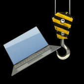 Yellow crane hook lifting laptop — Stock Photo