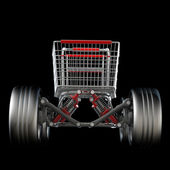 Shopping cart with big car wheel — Stock Photo