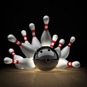 Bowling Ball crashing into the pins — Stock Photo