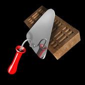 Brick and metal trowel — Stock Photo