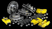 Disassembled brake discs with yellow calliper from racing cars — Stock Photo