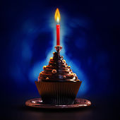 Holiday cupcake with candle — Stock Photo