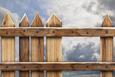 Wooden fence with hole — Stock Photo