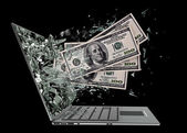 Dollars exit by a monitor of laptop screen — Stock Photo