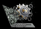 Gear wheels exit by a monitor of laptop screen — Stock Photo