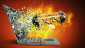 Capsule with Virus on fire exit by a monitor of laptop screen — Stock Photo