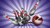 Bowling Ball crashing into the pins — Stock Photo