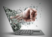 Fist exit from laptop. — Stock Photo