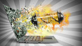 Capsule with Virus on fire exit by a monitor of laptop scree — Stock Photo