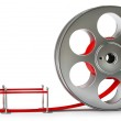 Cinema film roll and red carpet — Stock Photo