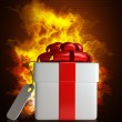 Gift box with the Tag in Fire — Stock Photo #32146189
