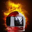 Red moto helmet in Fire — Stock Photo