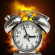 Old-fashioned alarm clockin Fire — Stock Photo