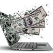 Dollars exit by a monitor of laptop screen. — Stock Photo
