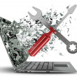 Screwdriver and Wrench exit by a monitor of laptop screen.  — Stock Photo