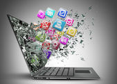 Laptop with color application icons — Stock Photo