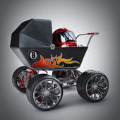 Baby super Carriage with small racer in a helmet — Stock Photo