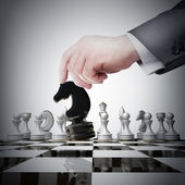 Hand holding black chess figure — Stock Photo