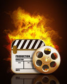 Film and clap board movies symbol in Fire — Stock Photo